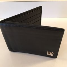 D&G BLACK LEATHER WALLET 100% AUTHENTIC D&G BLACK LEATHER WALLET 100 % AUTHENTIC.  BEAUTIFUL ITALIAN LEATHER WALLET.  VERY GENTLY USED AND LOVED . PURCHASED AT THE D&G  BOUTIQUE IN LAS VEGAS. D&G Bags Wallets