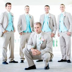 Groomsmen wore light gray suits with bright blue vests and black shoes.