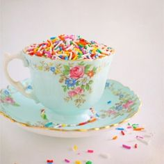 love teacups and sprinkles. And i just got an idea--- cupcake paper things shaped like tea cups