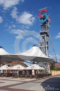 """Antique tower shaft """"Jerzy"""" remains of the former coal mine KWK Gottwald at the entrance to the Silesia City Center, a shopping mall in Katowice, Poland In 2015, Coal Mining, Shopping Mall, Poland, Entrance, Tower, Stock Photos, Country, Antiques"""