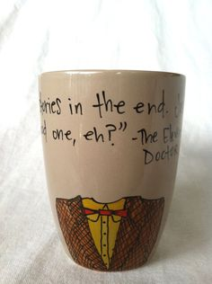 "Doctor Who ""We're all stories in the end"" Eleventh Doctor quote with jacket and bowtie - medium sized mocha brown cup. $14.00, via Etsy."