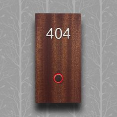 "Axxess custom hotel room number sign with solid wood face, ADA-compliant raised numbers and braille, and doorbell with LED-lit ring indicator for ""do not disturb"" and ""ready for housekeeping"""