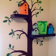 For baby's room- tree painted on wall with shelving over branches.
