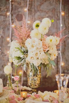 Centerpieces in mercury glass vases // photo by Our Labor of Love by Heidi, styling by @Jackie Godbold Godbold Godbold Godbold Godbold Gregory Charming Socials http://ruffledblog.com/atlanta-arts-center-wedding #mercuryglass #centerpieces #flowers
