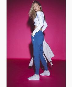 Gigi Hadid stars in Reebok Classic s spring 2018 campaign. Hadid wears blue  sweatpants and a cropped shirt with sneakers in the new ads. b442ae162