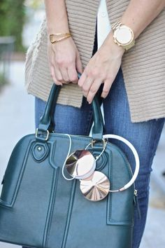 Green structured dome satchel with sophisticated raised quilting. The perfect everyday bag for fall!