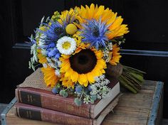 Rustic Sunflower Wedding Bouquet I love these colors together. We could do a blue table cloth.