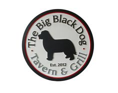 Restaurant sign for The Big Black Dog Tavern & Grill. Double sided hdu routed sign, hanging above entrance. Strata Signs. www.customoutdoorwoodensigns.com