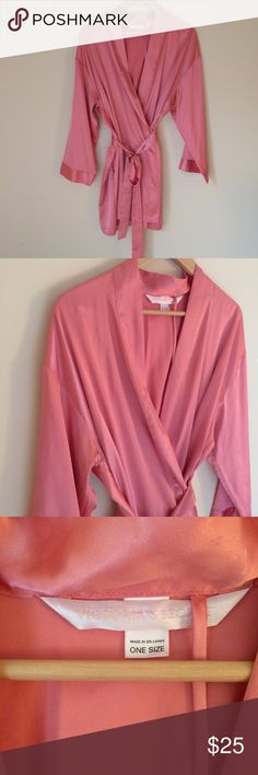 Victoria's Secret Pink Satin Short Robe Tie Waist Hanging loop untacked on one side- see photos.   Garment measurements in inches: Bust: 48 Waist: 48 Sleeve: 30 Length: 35 100% polyester Victoria's Secret Intimates & Sleepwear Robes