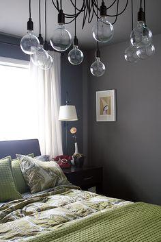 moody gray bedroom, green textiles, fabulous Edison chandelier