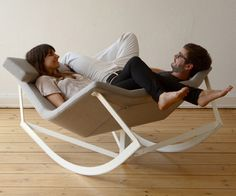 """Sway by Markus Krauss. """"Sway is a rocking chair with a padded seat and a steel rack. The shape of the seat enables many-sided use even in pairs. The telescope mechanism locates the rocking chair in an easy chair position. """""""