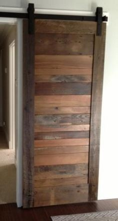 RLP Reclaimed Sliding Track Barn Doors. This is a door we keep in stock with a natural grey dye added to darken the look. http://www.reclaimedlumberproducts.com/product/reclaimed-wood-barn-door-slab