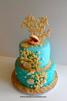 Mini beach themed cake with golden coral
