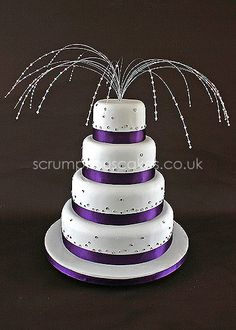 Wedding Cake - Purple Ribbon with Diamantes and Swarovski Topper by Scrumptious Cakes (I don't like the topper)