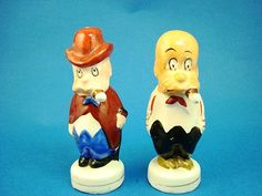 """These vintage salt and pepper shakers depict the 1920's cartoon character Adamson, more commonly known as """"Silent Sam"""", from Oscar Jacobbson's """"Adamson's Adventures"""" about a silent little cigar-smoking man with a big hat and frequent misadventures. Made in Japan."""