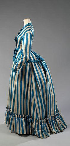 Victorian 1880s. I don't love the style but the fabric and colors are wonderful!