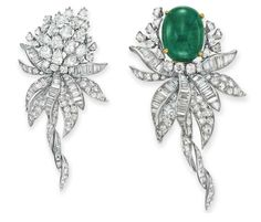 A DIAMOND AND EMERALD FLOWER BROOCH, BY DAVID WEBB  Designed as a flower, set with a detachable oval cabochon emerald pistil, with shield-shaped diamond buds, to the circular and baguette-cut diamond leaves and stems; accompanied by an interchangeable pear-shaped diamond cluster pistil, mounted in platinum and gold, circa 1963