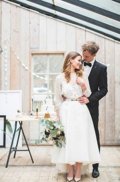 Minimalist wedding inspiration with a two piece long sleeved wedding dress, black suit and simplistic decor! https://www.theprettyblog.com/wedding/a-modern-take-on-a-classic-look/?utm_campaign=coschedule&utm_source=pinterest&utm_medium=The%20Pretty%20Blog&utm_content=How%20to%20Pull%20Off%20a%20Modern%20Minimalist%27s%20Wedding%20in%20Style