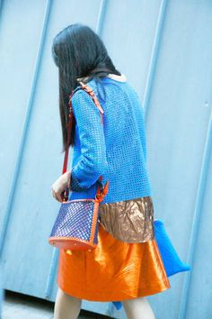 A pop of orange, spotted on Susie Bubble in Paris, is a cheerful surprise #streetstyle