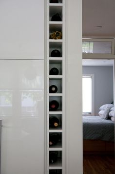 Creative storage for small places. I might have to try this home made storage to fill the void between my refrigerator and the wall.