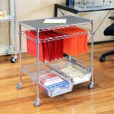 Reduce clutter and keep your files organized with Seville Classics 3-Tier Office File & Utility Cart. This multipurpose cart features three tiers--each designed to serve a different purpose. Constructed from industrial-strength steel wire and finished in bright, chrome plating, the unit is sturdy and lightweight. The hanging file folder tier features steel wire rails perfect for organizing papers and documents in Letter-size and Legal-size hanging folders. The mesh basket tier includes me...
