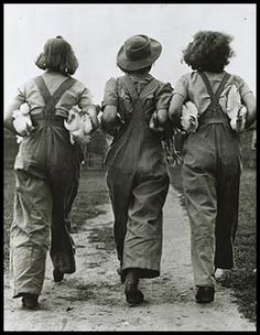 We Can Do It  Armed with volunteer spirit—and armloads of chickens—a trio from Britain's Women's Land Army did its part for the war effort in 1940: Fighting the food shortage at home while their men fought for freedom abroad.    Photograph from Hulton Archive/Getty Images, 1940