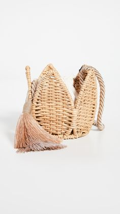 Fabric: Wicker Tassel accents Drawstring top Rope crossbody strap Lined Weight: / Imported, Brazil Measurements Height: / Length: / Depth: / Strap drop: / How To Make Handbags, Summer Accessories, Cute Bags, Bucket Bag, Wicker, Tassels, Floral Design, Brazil, Basket