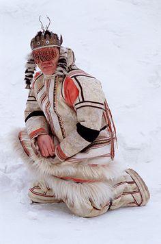 Velodeya Turdalgin, a Nganasan man, wearing traditional clothing and a Shaman's headdress. Taymyr, Northern Siberia, Russia