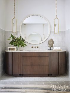 Aiming to recreate luxurious spa appointments in five-star style, Cydney Mitchell and Brittany Stafford of Source outfitted the master bath with a chic, West Coast-inspired design. To achieve that laid-back California feel, the designers chose calm colorways and focused their attention on bringing nature into the design. Lavatory Faucet, Bathroom Faucets, Master Bathroom, Bathrooms, Wall Mount Faucet, California Cool, Classic Bathroom, Atlanta Homes, Bedside Table Lamps