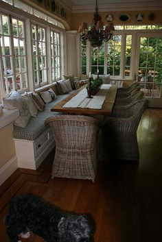 built in bench and rustic table...I also love all of the windows and wood floor...lovely room