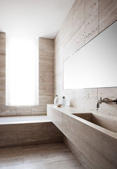 Fanny Bauer Grung and David Lopez Quincoces of Quincoces-Dragò & Partners, reworked a heritage apartment in Rome for a young couple who gained possession of a flat with beautiful features but a less than ideal floor plan. | minimalist bathroom