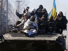 Ukrainian soldiers ride an armored personnel carrier as they leave Debaltseve.  Anatolii Stepanov, AFP/Getty Images