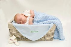 Baby in a basket with personalized blankie