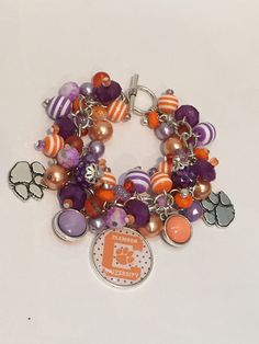 Handmade Clemson Charm Bracelet: Chunky Cluster Bracelet with various Purple, Lavender and Orange beads by RoyalStreetBoutique on Etsy
