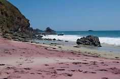Pfeiffer Beach in Los Padres National Forest along California's Central Coast. The sand's purple color comes from manganese garnet deposits found in the surrounding rocks.