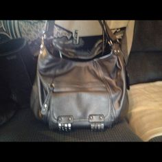 Jessica Simpson Brown Purse Brown Purse, lots of pockets. Only used 3 times. No signs of wear or debris. By Jessica Simpson. Bags Shoulder Bags