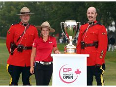 REGINA, CANADA - AUGUST 26: Brooke Henderson of Canada with the champions trophy and Canadian Mounties following the final round of the CP Women's Open at the Wascana Country Club on August 26, 2018  | Calgary Sun