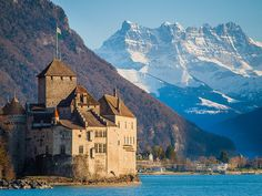 Chateau de Chillon, Veytaux, Montreux, Switzerland -- an island castle located on the shore of Lake Geneva, 3 km from Montreux. Places Around The World, Oh The Places You'll Go, Travel Around The World, Places To Travel, Places To Visit, Around The Worlds, Beautiful Castles, Beautiful Places, Glacier Express