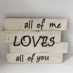 """- Sign made from reclaimed fence pickets reads """"All of me loves all of you"""" - measures 17 inches x 17 inches - painted in off white, distressed and lettering applied in blac - finished with a protecti"""