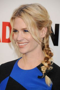 January Jones January Jones shows off her multi-tonal locks with an undone, loopy braid that finishes with a velvet bow.