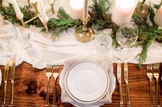 Minimal holiday decor with white candles, gauzy table runner, gold flatware. Garland.  Photography : Hunter Ryan Photo Read More on SMP: http://www.stylemepretty.com/living/2016/12/09/a-cozy-candlelit-holiday-gathering/