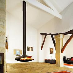 This iconic fire, designed in 1968, was the first suspended 360° pivotable fire.