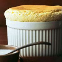Vanilla Bean Souffle with Vanilla Custard Sauce - Soufflés intimidate me, but this one may be worth trying!