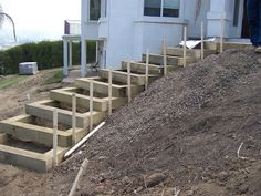 from: The 2 Minute Gardener: Garden Elements - Landscape Timber Stairs (seriously, 2 minutes??? LOL)