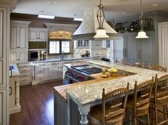 Island with stove and eat-in!  Love the butcher block & gas range plus the elevated seating