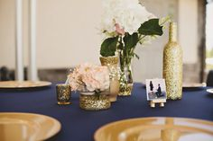Navy and gold wedding decor. Mini canvases for photos instead of frames