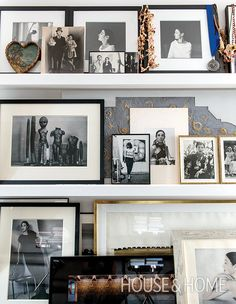 Instead of hanging photos throughout the loft, portraits and mementoes are layered on floating shelves in the den for a curated, personal feel. | Photographer:  Christian Schaulin