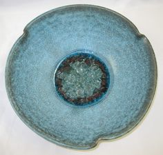 I wonder if my studio allows glass in the kiln, because I love things like this. I also love the waving rim.