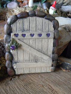 <3 Gorgeous fairy door with purple hearts. Look at the little door knob!