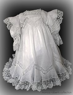 Antique French child's dress lavished with pintucks and chemical lace (sounds horrid), which was produced by coating the underlying fabric with a chemical that allowed it to dissolve whilst leaving the remaining lace pattern intact. Every stitch on this dress is done by hand ... and let me tell you making it must have taken months to complete, as the ironing of it alone was enough to make me want to cry. ca. 1910